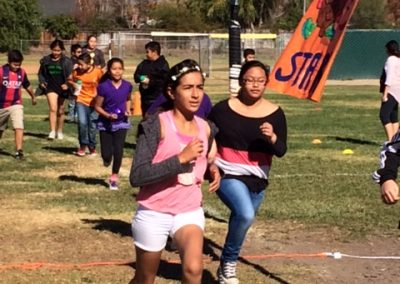 Group of middle school age students running at the Santa Ynez Fun Run.